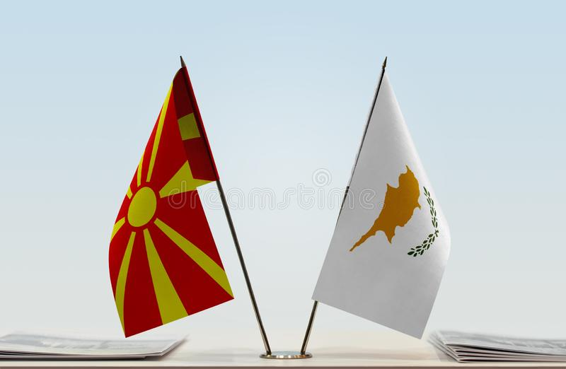 Flags of Macedonia and Cyprus. Two table flags of Republic of North Macedonia FYROM, RNM, RONM and Cyprus royalty free stock photos
