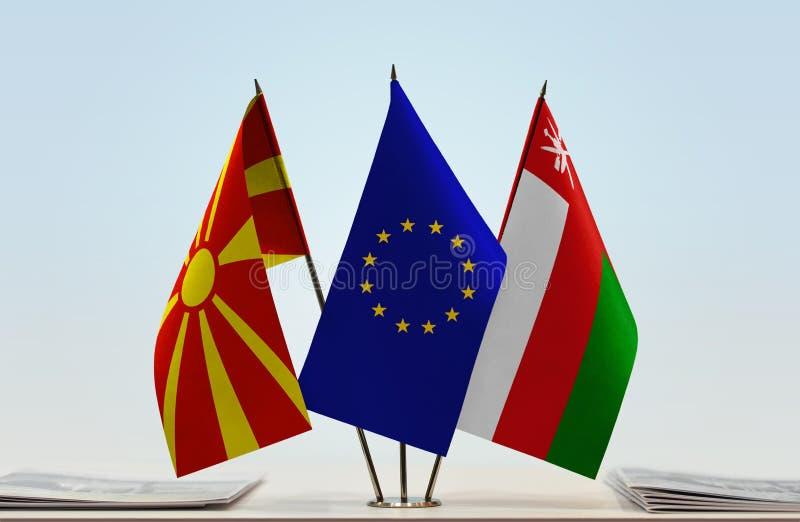 Flags of Macedonia EU and Oman stock photo
