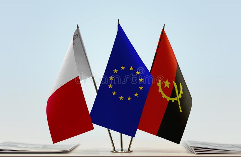 Flags of Malta EU and Angola. Desktop flags of Malta and Angola with European Union flag in the middle stock image