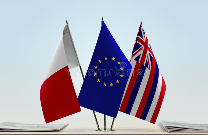 Flags of Malta EU and Hawaii. Desktop flags of Malta and Hawaii with European Union flag in the middle stock photos