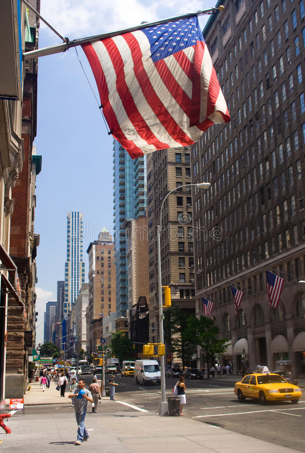 Flags and Manhattan. Flag lined street and checker cab in Manhattan, New York City stock images