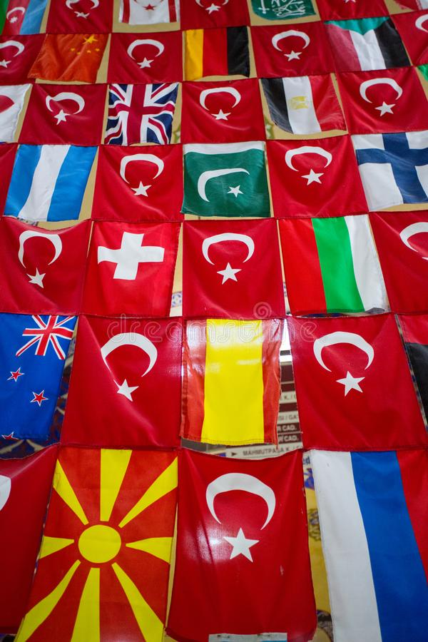Flags of many countries. Flags of many different countries are for sale in the Grand Bazaar in Istanbul royalty free stock image