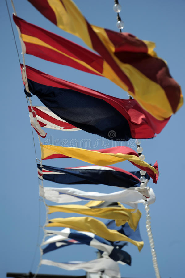 Flags. Maritime flags flying on the deck of a cruise ship royalty free stock image