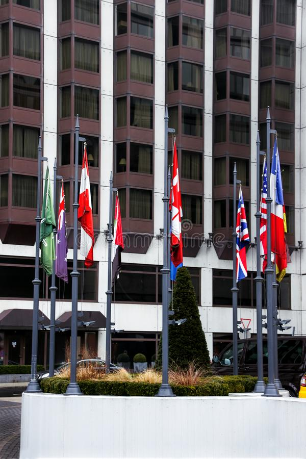 The flags on the masts of the building royalty free stock photos