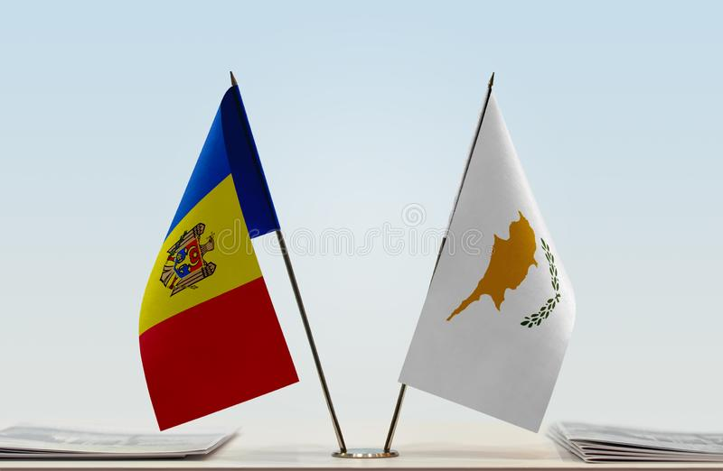 Flags of Moldova and Cyprus. Two table flags of Moldova and Cyprus stock photo