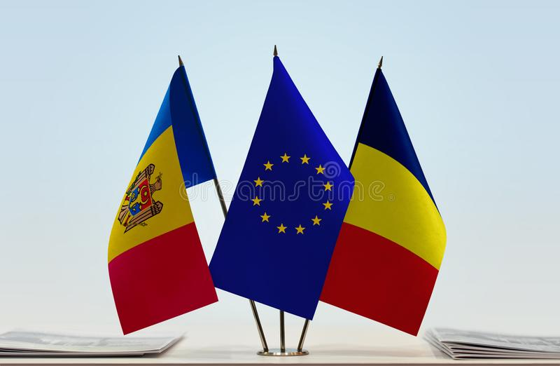 Flags of Moldova EU and Chad. Desktop flags of Moldova and Chad with European Union flag in the middle royalty free stock images