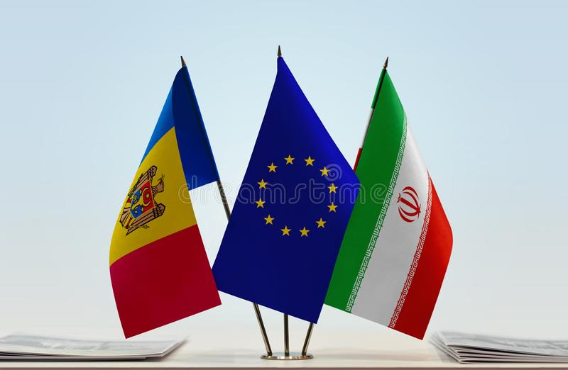 Flags of Moldova EU and Iran. Desktop flags of Moldova and Iran with European Union flag in the middle royalty free stock photo