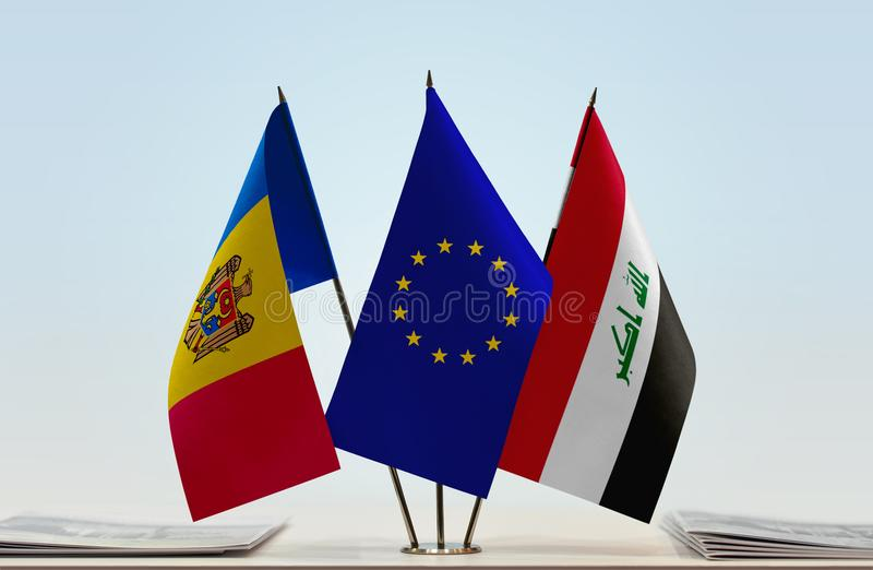 Flags of Moldova EU and Iraq. Desktop flags of Moldova and Iraq with European Union flag in the middle royalty free stock images