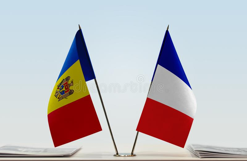 Flags of Moldova and France. Two table flags of Moldova and France stock photos