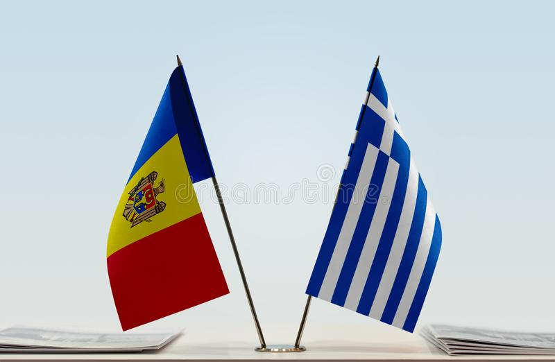 Flags of Moldova and Greece. Two table flags of Moldova and Greece royalty free stock photography