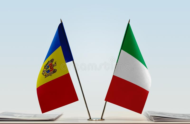 Flags of Moldova and Italy. Two table flags of Moldova and Italy stock photo