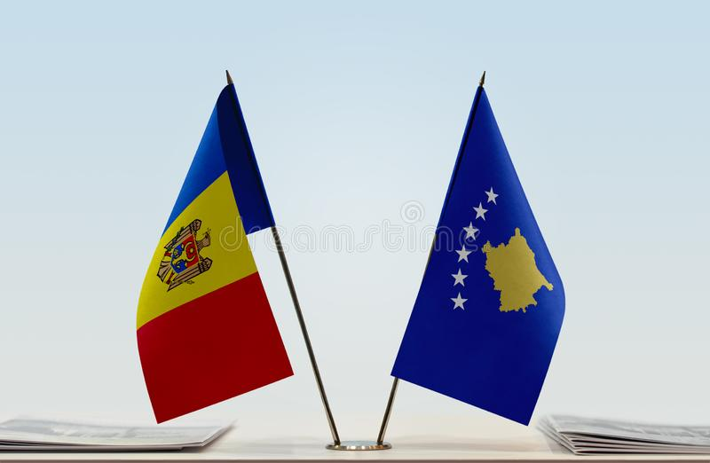 Flags of Moldova and Kosovo. Two table flags of Moldova and Kosovo stock photos