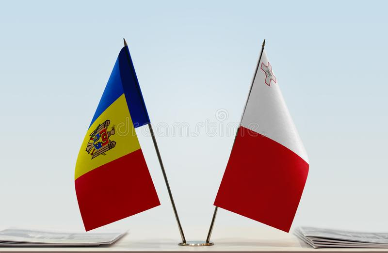 Flags of Moldova and Malta. Two table flags of Moldova and Malta stock photo