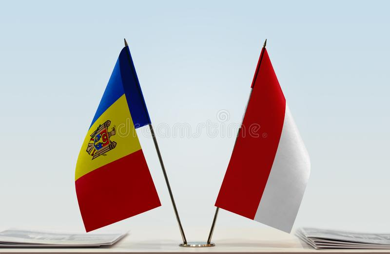 Flags of Moldova and Monaco. Two table flags of Moldova and Monaco stock images