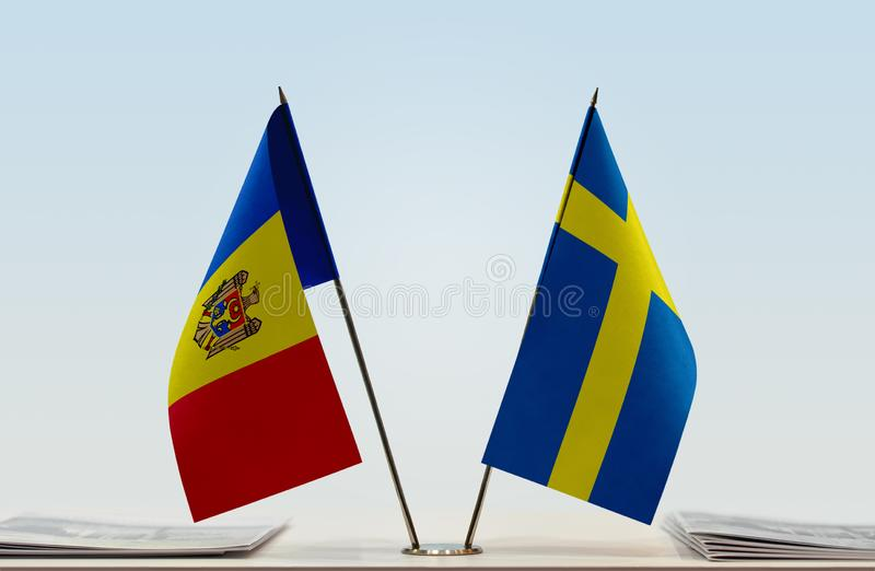 Flags of Moldova and Sweden. Two table flags of Moldova and Sweden royalty free stock photography