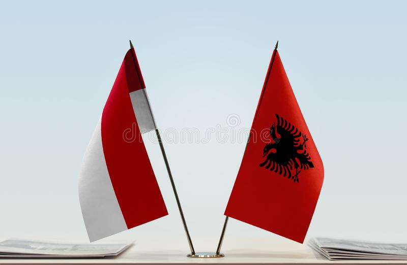 Flags of Monaco and Albania. Two table flags of Monaco and Albania stock image