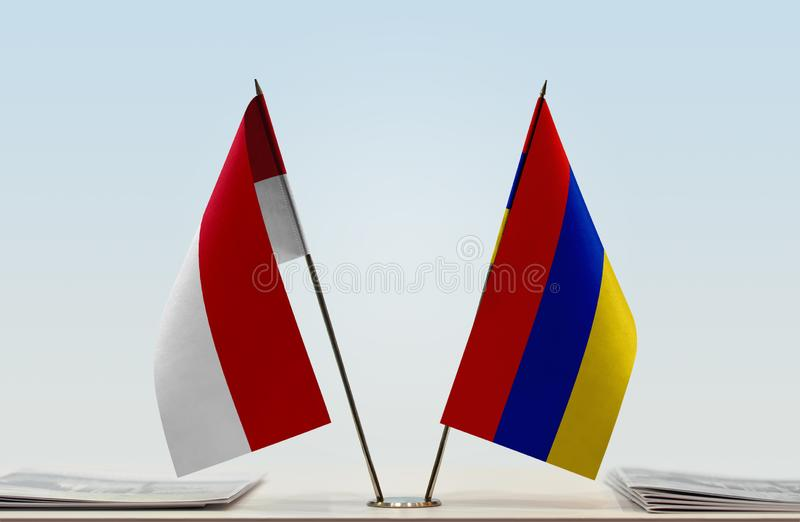 Flags of Monaco and Armenia. Two table flags of Monaco and Armenia royalty free stock photos