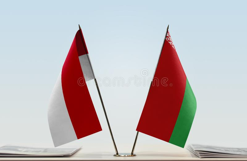 Flags of Monaco and Belarus. Two table flags of Monaco and Belarus royalty free stock photography