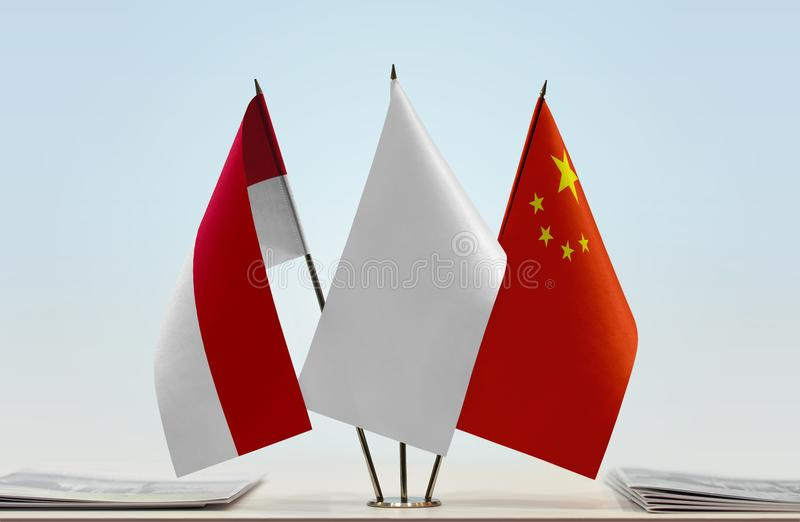 Flags of Monaco and China royalty free stock photo