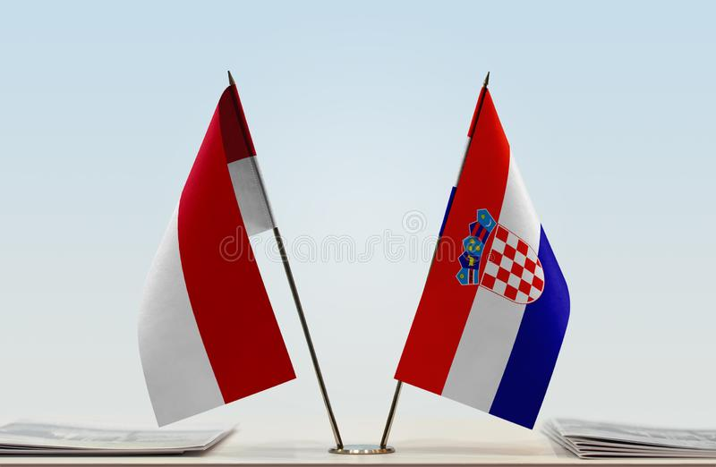 Flags of Monaco and Croatia. Two table flags of Monaco and Croatia royalty free stock photo