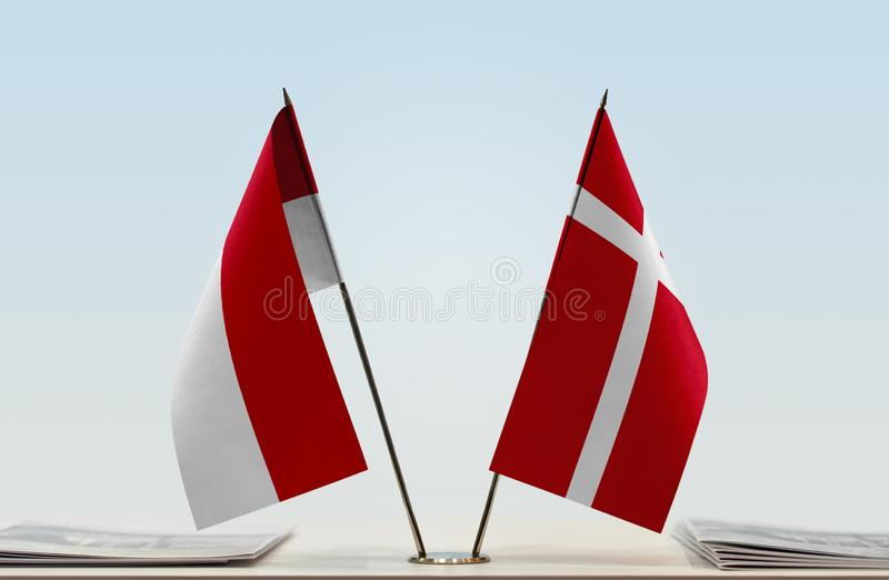 Flags of Monaco and Denmark. Two table flags of Monaco and Denmark stock images