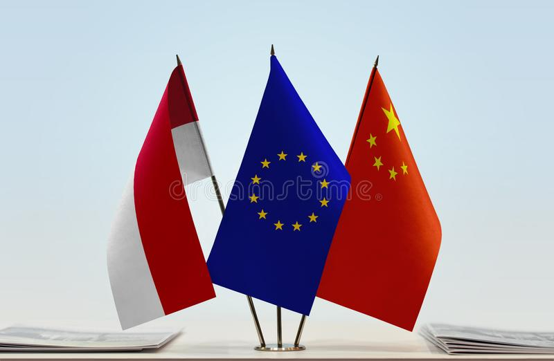 Flags of Monaco EU and China. Desktop flags of Monaco and China with European Union flag in the middle stock images