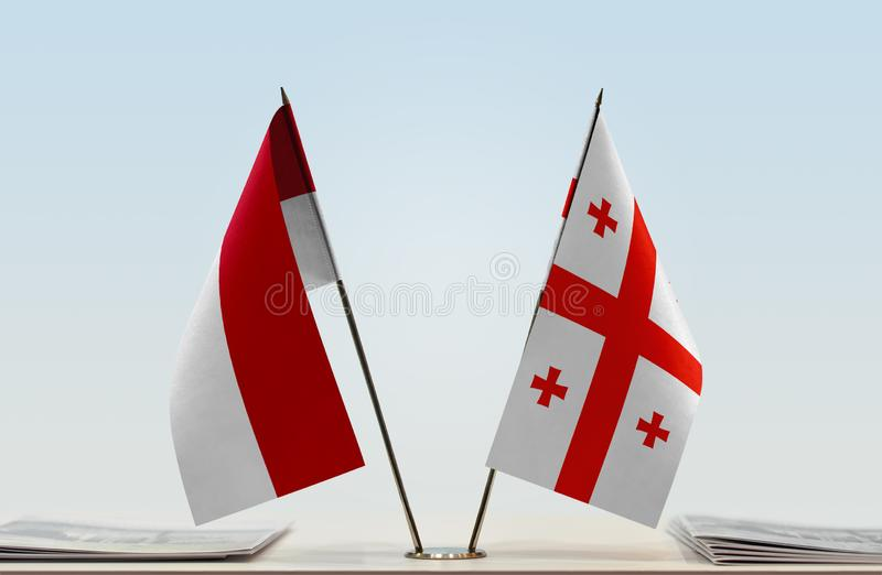 Flags of Monaco and Georgia. Two table flags of Monaco and Georgia stock photography