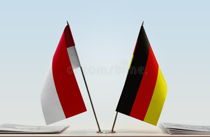 Flags of Monaco and Germany. Two table flags of Monaco and Germany stock photo