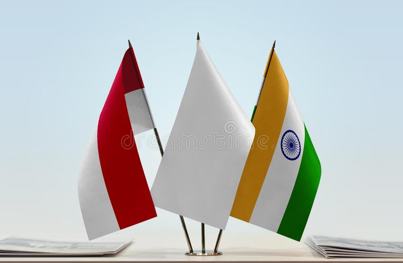 Flags of Monaco and India stock photo