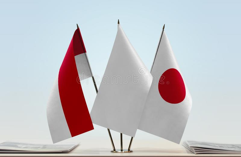 Flags of Monaco and Japan. Desktop flags of Monaco and Japan with white flag in the middle stock photos