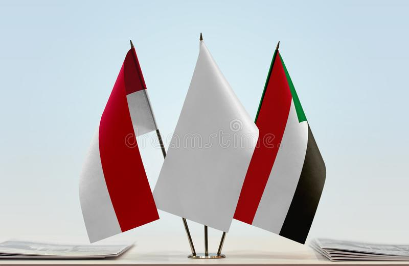 Flags of Monaco and Sudan. Desktop flags of Monaco and Sudan with white flag in the middle royalty free stock photos