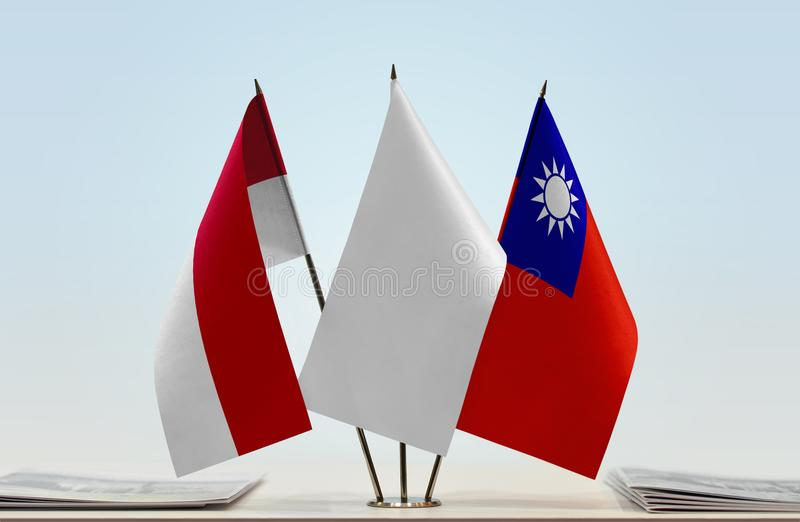 Flags of Monaco and Taiwan royalty free stock photo