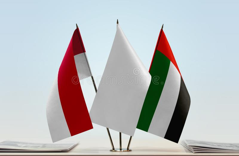 Flags of Monaco and UAE royalty free stock photo
