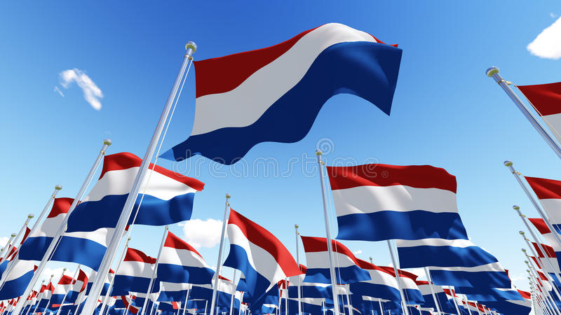 Flags of Netherlands waving in the wind against blue sky. royalty free illustration
