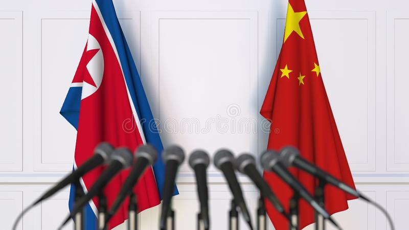 Flags of North Korea and China at international meeting or conference. 3D rendering. Flags of North Korea and China at international meeting or conference. 3D stock images