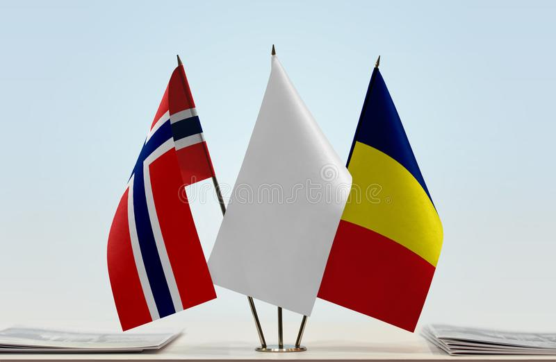 Flags of Norway and Chad. Desktop flags of Norway and Chad with white flag in the middle stock images