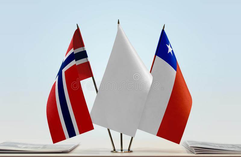 Flags of Norway and Chile. Desktop flags of Norway and Chile with white flag in the middle stock image