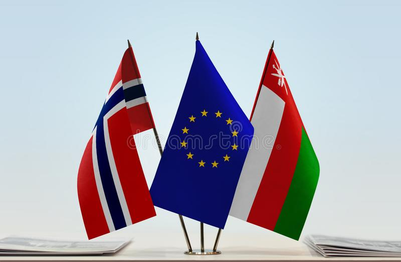 Flags of Norway EU and Oman. Desktop flags of Norway and Oman with European Union flag in the middle royalty free illustration