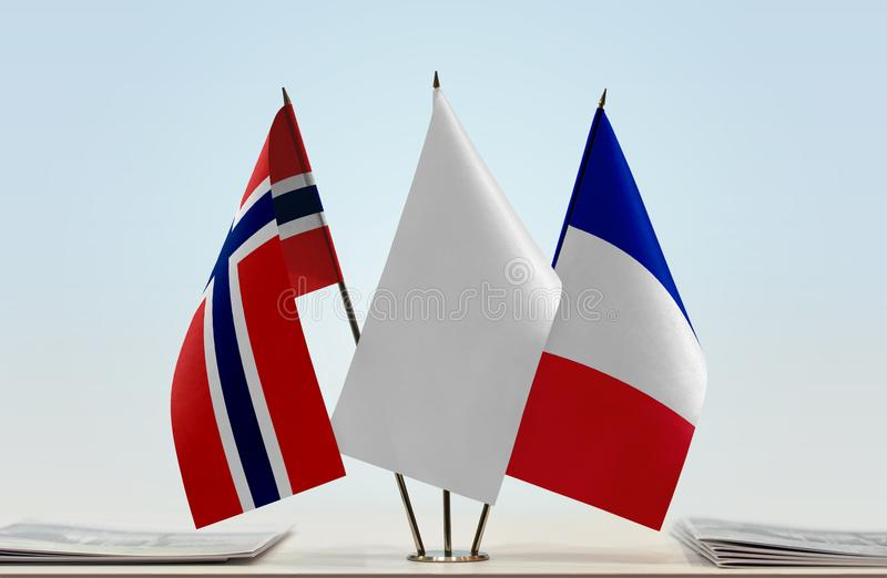 Flags of Norway and France. Desktop flags of Norway and France with a white flag in the middle stock photo