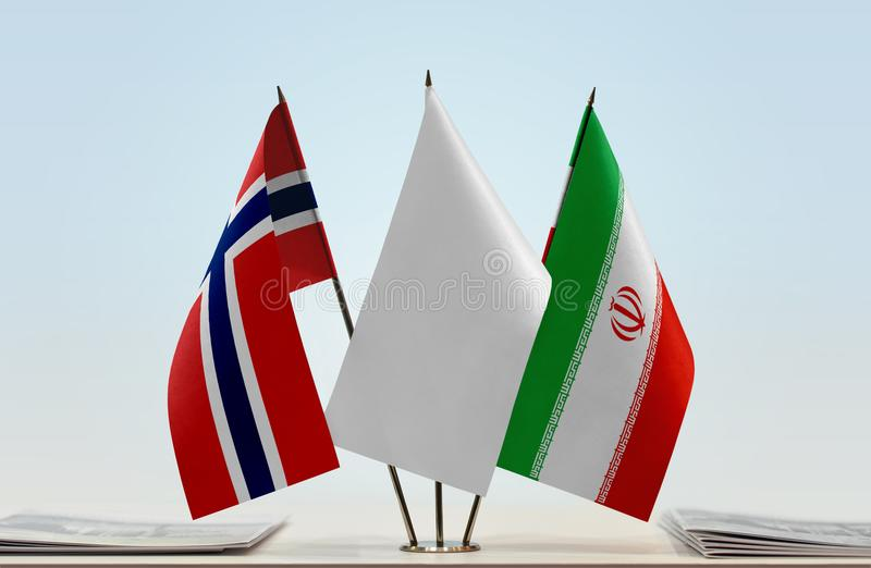Flags of Norway and Iran. Desktop flags of Norway and Iran with white flag in the middle royalty free stock image