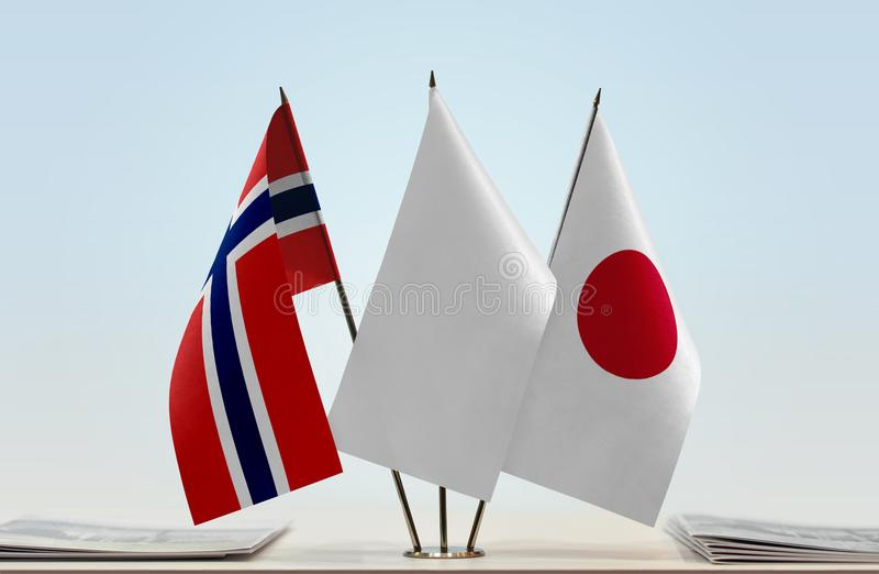 Flags of Norway and Japan stock photos