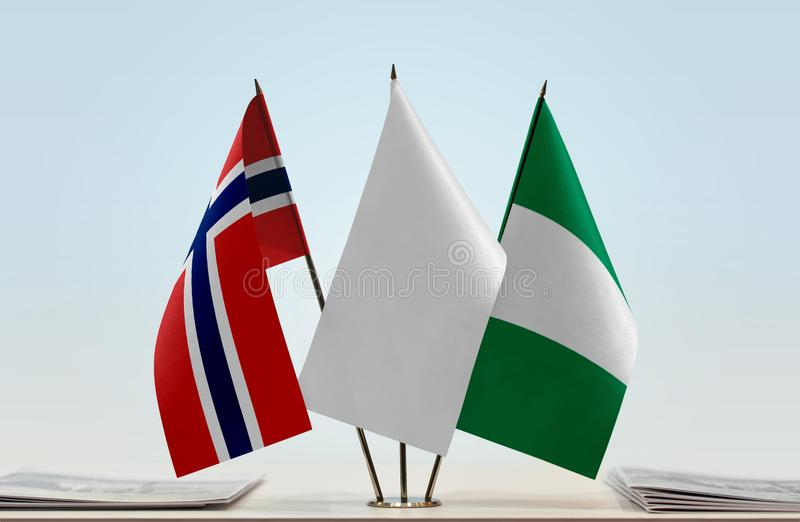 Flags of Norway and Nigeria. Desktop flags of Norway and Nigeria with white flag in the middle royalty free stock photo