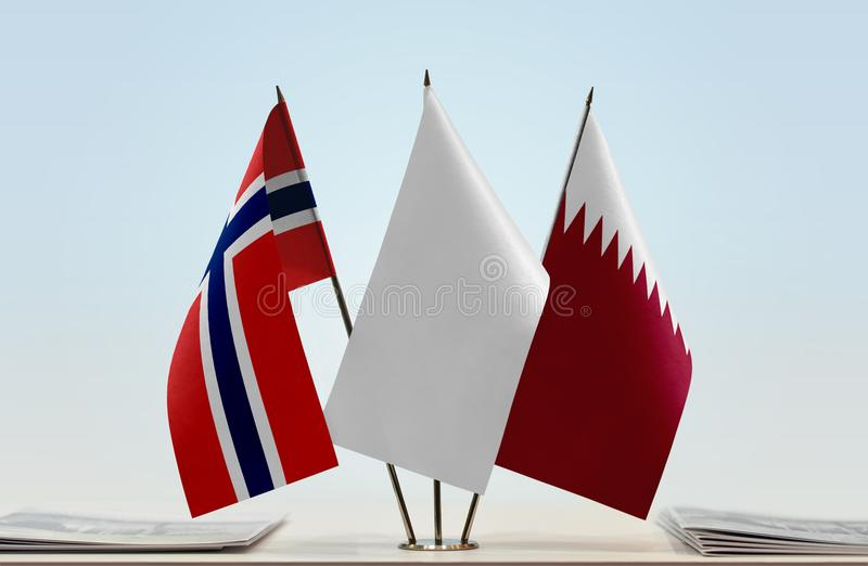 Flags of Norway and Qatar royalty free stock photos