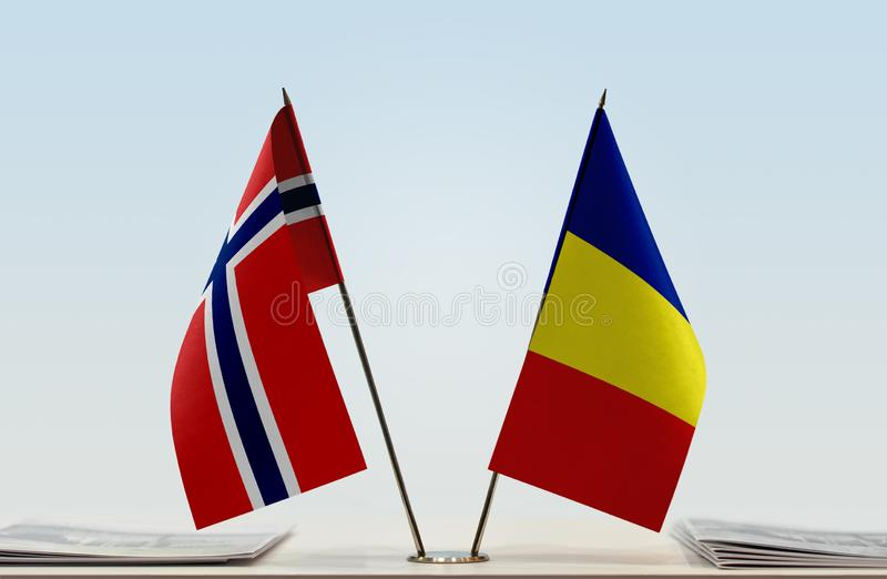Flags of Norway and Romania. Two table flags of Norway and Romania stock photography