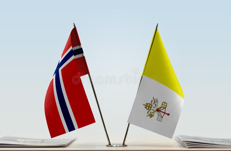Flags of Norway and Vatican. Two table flags of Norway and Vatican royalty free stock image