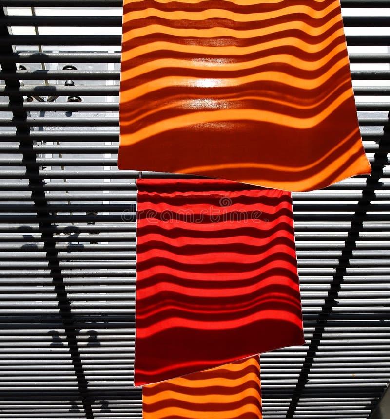 flags orange red arkivfoto
