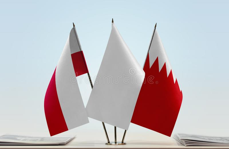 Flags of Poland and Bahrain. Desktop flags of Poland and Bahrain with white flag in the middle stock photography