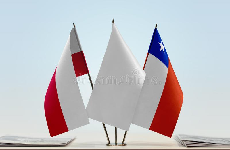 Flags of Poland and Chile. Desktop flags of Poland and Chile with white flag between stock photos