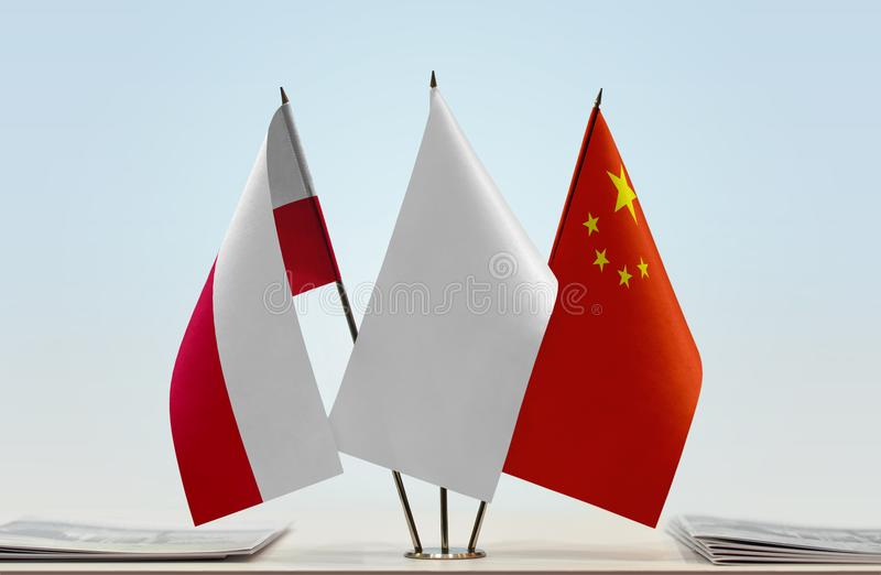 Flags of Poland and China. Desktop flags of Poland and China with white flag between stock photos