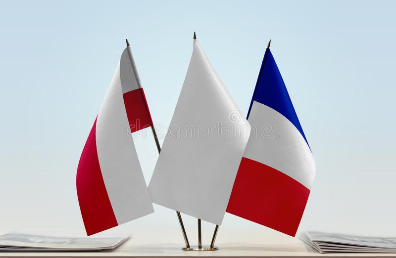 Flags of Poland and France. Desktop flags of Poland and France with a white flag in the middle stock photography